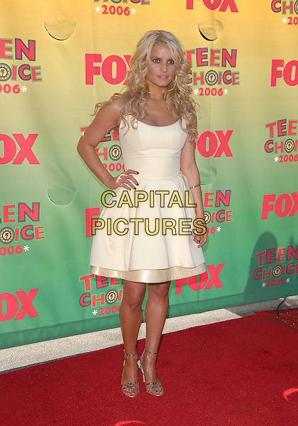 JESSICA SIMPSON.At The 2006 Teen Choice Awards - Arrivals, .held at The Universal Ampitheatre in Universal City, California, USA, August 20th 2006..full length cream dress puffy skirt dark nail polish varnish hand on hip leopard print shoes strappy sandals.Ref: DVS.www.capitalpictures.com.sales@capitalpictures.com.©Debbie VanStory/Capital Pictures