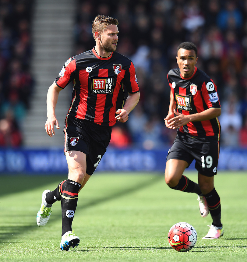 Bournemouth's Simon Francis &amp; Bournemouth's Junior Stanislas in action during todays match  <br /> <br /> Bournemouth 1 - 4 Chelsea 4<br /> <br /> Photographer David Horton/CameraSport<br /> <br /> Football - Barclays Premiership - Bournemouth v Chelsea - Saturday 23rd April 2016 - Vitality Stadium - Bournemouth<br /> <br /> &copy; CameraSport - 43 Linden Ave. Countesthorpe. Leicester. England. LE8 5PG - Tel: +44 (0) 116 277 4147 - admin@camerasport.com - www.camerasport.com