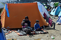 Pictured: A young mother with her two children in the camp Tuesday 01 March 2016<br />Re: Thousands of migrants, still stranded at the Greek FYRO Macedonian border in Idomeni, Greece