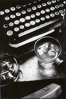 Still life with typewritter, drinking glass and ashtray<br />