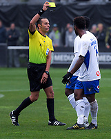 Referee Kader Zitouni yellow cards Lautoka's Ben Totori during the Oceania Football Championship final (first leg) football match between Team Wellington and Lautoka FC at David Farrington Park in Wellington, New Zealand on Sunday, 13 May 2018. Photo: Dave Lintott / lintottphoto.co.nz