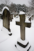 Snow on memorials and gravestones in Hampstead cemetery, West Hampstead