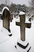 Snow on memorials and gravestones in Hampstead cemetery, West Hampstead