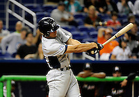 Florida International University infielder/outfielder Oscar Aguirre (8)plays against the Miami Marlins, which won the game 5-1 on March 7, 2012 at Miami, Florida. .