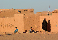 People is pictured on December 13, 2003, in the Saharawi refugee camps. Saharawi people have been living at the refugee camps of the Algerian desert named Hamada, or desert of the deserts, for more than 30 years now. Saharawi people have suffered the consecuences of European colonialism and the war against occupation by Moroccan forces. Polisario and Moroccan Army are in conflict since 1975 when Hassan II, Moroccan King in 1975, sent more than 250.000 civilians and soldiers to colonize the Western Sahara when Spain left the country. Since 1991 they are in a peace process without any outcome so far. (Ander Gillenea / Bostok Photo)
