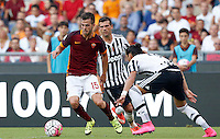 Calcio, Serie A: Roma vs Juventus. Roma, stadio Olimpico, 30 agosto 2015.<br /> Roma&rsquo;s Miralem Pjanic, left, is challenged by Juventus&rsquo; Stefano Sturaro, center, and Martin Caceres during the Italian Serie A football match between Roma and Juventus at Rome's Olympic stadium, 30 August 2015.<br /> UPDATE IMAGES PRESS/Riccardo De Luca