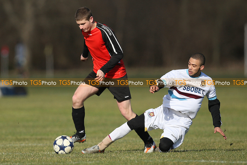 Romania Galaxy (red/black) vs Reama - East London Sunday League Football at South Marsh, Hackney Marshes, London - 19/02/12 - MANDATORY CREDIT: Gavin Ellis/TGSPHOTO - Self billing applies where appropriate - 0845 094 6026 - contact@tgsphoto.co.uk - NO UNPAID USE.