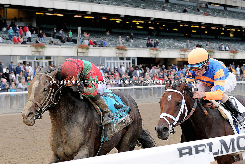 Flat Out (red cap), ridden by Joel Rosario, wins the TVG Jockey Club Gold Cup Invitational Stakes (GI) at Belmont Park in Elmont, New York on September 29, 2012.