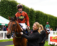 Red Dragon ridden by Rob Hornby and trained by Michael Blanshard is led into the winners enclosure after winning the Winner of Dartmouth General Contractors Ltd Handicap (Div 1),  during Afternoon Racing at Salisbury Racecourse on 7th August 2017