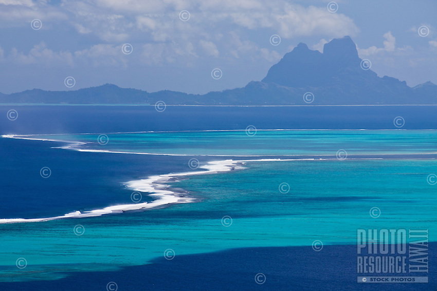 View of Bora Bora and surrounding reefs in the background from Raiatea island