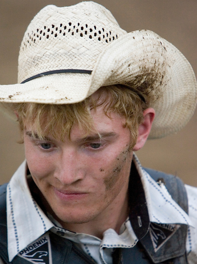 A cowboy wears mud after a ride during the Miles City Bucking Horse Sale at the Eastern Montana Fairgrounds in Miles City Montana Sat., May 19, 2007. Saddle broncs and bareback broncs are auctioned off after they are bucked.