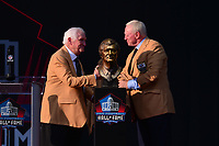 Canton, Ohio - August 3, 2019: Gil Brandt unveils his bust with Dallas Cowboy's owner Jerry Jones at the Tom Benson Hall of Fame Stadium in Canton, Ohio August 3, 2019 after his induction into the Pro Football Hall of Fame.  (Photo by Don Baxter/Media Images International)