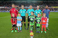 Match officials, referee Andrew Marriner, team captains Simon Francis of Bournemouth (L) and Ashley Williams of Swansea (R) with children mascots before the Barclays Premier League match between Swansea City and Bournemouth at the Liberty Stadium, Swansea on November 21 2015