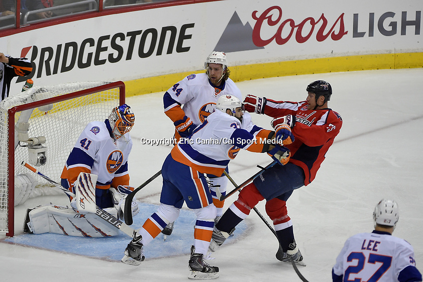 April 15, 2015 - Washington D.C., U.S. - New York Islanders defenseman Brian Strait (37) protects goalie Jaroslav Halak (41) by blocking Washington Capitals left wing Jason Chimera (25) during game 1 of the  NHL Eastern Conference Quarter finals between the New York Islanders and the Washington Capitals held at the Verizon Center in Washington D.C. Eric Canha/CSM