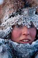 Kristy Berington is frosted up after her run from Cripple to Ruby, 2010 Iditarod Sled Dog Race, Alaska