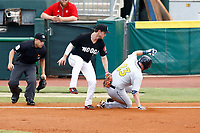 Ryan Boldt (23) of the Montgomery Biscuits slides safely into third base as Chattanooga Lookouts Chris Paul (5) applies the tag on May 26, 2018 at AT&T Field in Chattanooga, Tennessee. (Andy Mitchell/Four Seam Images)