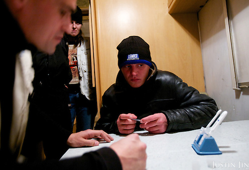 A man who uses intravenous drugs tests his blood at an Outreach Program point in St Petersburg. He tested positive.