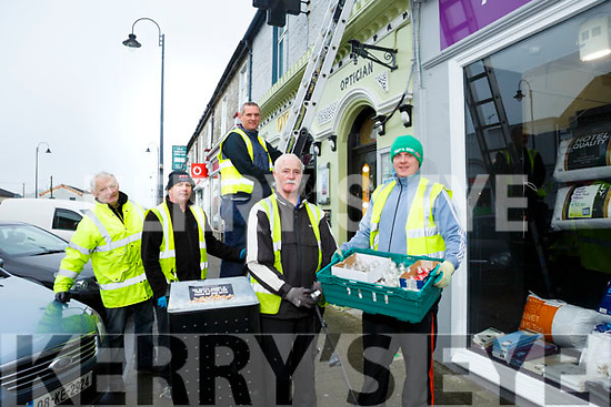 Hanging the Christmas lights in Listowel on Friday were front l-r Neilus O'Sullivan, Gearoid Moriarty, back l-r Sean Moriarty, John Costello,  Connor Moriarty  of Moriarty Electrical Contractors.