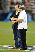 1 October 2011:  FIU President Mark B. Rosenberg congratulates FIU Law School Dean Alex Acosta on achieving the highest bar passage rate in Florida during a time out in the second quarter.  The Duke University Blue Devils defeated the FIU Golden Panthers, 31-27, at FIU Stadium in Miami, Florida.