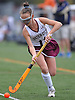 Ella Heaney #11 of Garden City moves the ball downfield during a Nassau County Conference I varsity field hockey match against Baldwin at Garden City High School on Friday, Sept. 30, 2016. She scored one goal in Garden City's 7-0 win.