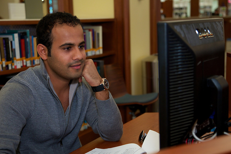Saud Al Tamimi utilizes a PC workstation in the DePaul University John T. Richardson Library Information Commons. (Photo by Jeff Carrion)