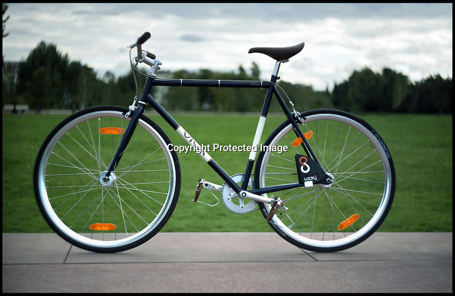 BNPS.co.uk (01202 558833)<br /> Pic: Lock8/BNPS<br /> <br /> ***Please use full byline***<br /> <br /> A high-tech bike lock has been invented to combat thieves - by sending a message to the owner every time someone tries to tamper with it.<br /> <br /> The black, triangular device is attached to a normal bike chain but is equipped with Bluetooth technology.<br /> <br /> It can be locked and unlocked remotely using Android or iOS smartphones and tablets, and had special sensors to detect any thieves.<br /> <br /> The LOCK8 costs around £110 and is available for pre-order online.