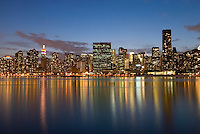 AVAILABLE FROM JEFF AS A FINE ART PRINT.<br /> <br /> AVAILABLE FROM CORBIS FOR COMMERCIAL AND EDITORIAL LICENSING.  Please go to www.corbis.com and search for image # 42-22813585.<br /> <br /> Midtown Manhattan Skyline at Dusk, Empire State Building, United Nations Headquarters and Trump World Tower Visible on the Skyline, New York City, New York State, USA