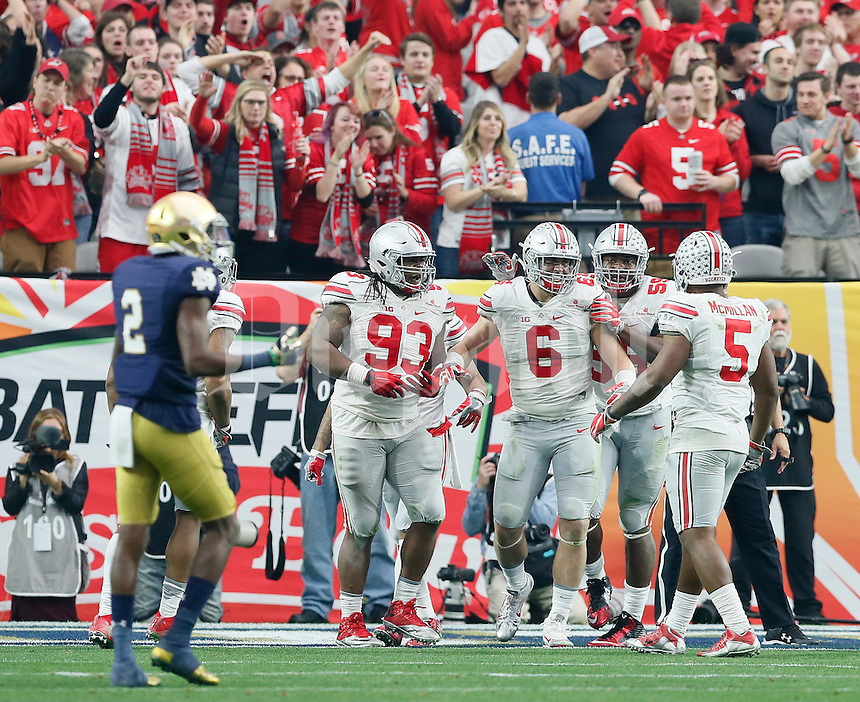 Ohio State players congratulate defensive end Sam Hubbard (6) on a sack of Notre Dame Fighting Irish quarterback DeShone Kizer (14) during the fourth quarter of the Battlefrog Fiesta Bowl at University of Phoenix Stadium in Glendale, Arizona on Jan. 1, 2016. Ohio State won 44-28. (Adam Cairns / The Columbus Dispatch)