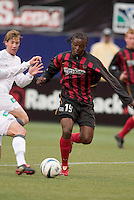 The MetroStars' Fabian Taylor about to be tackled as New England Revolution's Steve Ralston watches. The New England Revolution played the NY/NJ MetroStars to a 1 to 1 tie at Giant's Stadium, East Rutherford, NJ, on April 25, 2004.