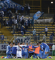 BOGOTÁ -COLOMBIA-23-03-2014.   Fortaleza FC por la fecha 12 de la Liga Postobón I 2014 jugado en el estadio Metropolitano de Techo en Bogotá./ Players of Millonarios pray after the victory against Fortaleza FC for the 12th date of Postobon League I 2014 played at Metropolitano de Techo stadium in Bogota. Photo: VizzorImage / Gabriel Aponte / Staff
