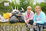 RUBBISH: Ballymacelligott residents Mary Riordan and Anne Leen beside the black bin bags and household rubbish dumped on the Old Castleisland Road on Saturday last.   Copyright Kerry's Eye 2008