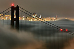The fog slipped underneath the Golden Gate Bridge of San Francisco, California.