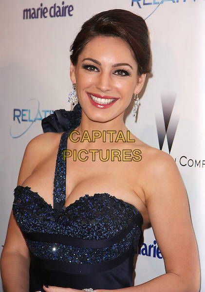 KELLY BROOK.Relativity Weinstein Company 68th Annual Golden Globe Awards After Party Presented by Marie Claire held at the Beverly Hilton, Beverly Hills, California, USA..January 16th, 2011.half length black purple blue navy one shoulder beads beaded hair up smiling cleavage  .CAP/ADM/TB.©Tommaso Boddi/AdMedia/Capital Pictures.