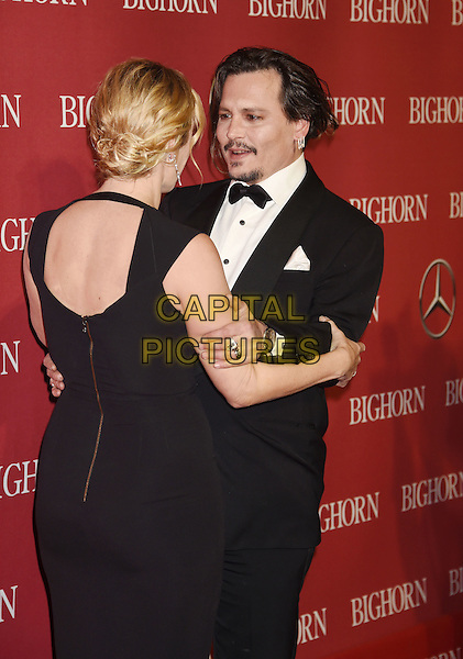 PALM SPRINGS, CA - JANUARY 02: Actress Kate Winslet and actor Johnny Depp attend the 27th Annual Palm Springs International Film Festival Awards Gala at Palm Springs Convention Center on January 2, 2016 in Palm Springs, California.<br /> CAP/ROT/TM<br /> &copy;TM/ROT/Capital Pictures