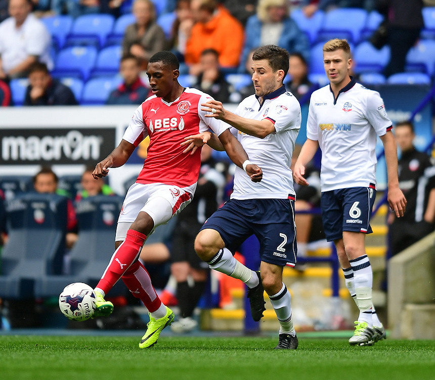 Fleetwood Town's Amari'i Bell shields the ball from Bolton Wanderers's Lewis Buxton<br /> <br /> Photographer Chris Vaughan/CameraSport<br /> <br /> Football - The EFL Sky Bet League One - Bolton Wanderers v Fleetwood Town - Saturday 20 August 2016 - Macron Stadium - Bolton<br /> <br /> World Copyright &copy; 2016 CameraSport. All rights reserved. 43 Linden Ave. Countesthorpe. Leicester. England. LE8 5PG - Tel: +44 (0) 116 277 4147 - admin@camerasport.com - www.camerasport.com