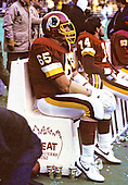 Washington Redskins left defensive tackle Dave Butz (65) watches the game action from the bench during the game against the Philadelphia Eagles at Veterans Stadium in Philadelphia, Pennsylvania on Sunday, December 21, 1986.  The Redskins won the game 21 - 14.<br /> Credit: Arnold Sachs / CNP