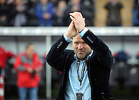 Former Swansea player Andy Robinson applauds home supporters before the Barclays Premier League match between Swansea City and Crystal Palace at the Liberty Stadium, Swansea on February 06 2016