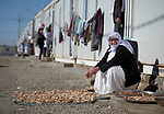 A Yazidi woman dries old bread in the sun in order to use it as animal feed in a camp for internally displaced persons at Dawodiya in Iraq's Kurdistan region. More than 600 Yazidi families living in the camp escaped from their communities in the Sinjar region during the attempted genocide by the Islamic State group. Although ISIS was militarily defeated in 2017, camp residents say it's still not safe to return home, nor do they have sufficient resources to rebuild their homes.<br /> <br /> The Lutheran World Federation, a member of the ACT Alliance, provides water, sanitation, garbage collection, and psycho-social support for the families in the camp.