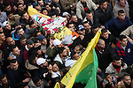 Palestinians carry the body of Fares al-Bayed, 16, who was shot and injured during clashes with Israeli soldiers in last October during his funeral, in the West Bank city of Ramallah, on December 23, 2016. Al-Bayed was critically injured after being shot in the head with a live bullet during clashes on Oct. 15 at al-Jalazun refugee camp in Ramallah, following a march commemorating the first anniversary of the killing of 13-year-old Ahmad Sharaka, who was shot and killed by Israeli forces last year during clashes. Photo by Shadi Hatem