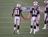 Feb 3, 2008; Glendale, AZ, USA; New England Patriots quarterback (12) Tom Brady with wide receiver (81) Randy Moss against the New York Giants during Super Bowl XLII at the University of Phoenix Stadium.  Mandatory Credit: Mark J. Rebilas-