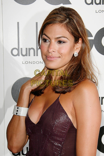 EVA MENDES .Attending the GQ Men Of The Year Awards 2009 held at the Royal Opera House, Covent Garden, London, England, UK, September 8th 2009..arrivals half length hand touching hair purple aubergine white cuff bracelet earring .CAP/DAR.©Darwin/Capital Pictures.