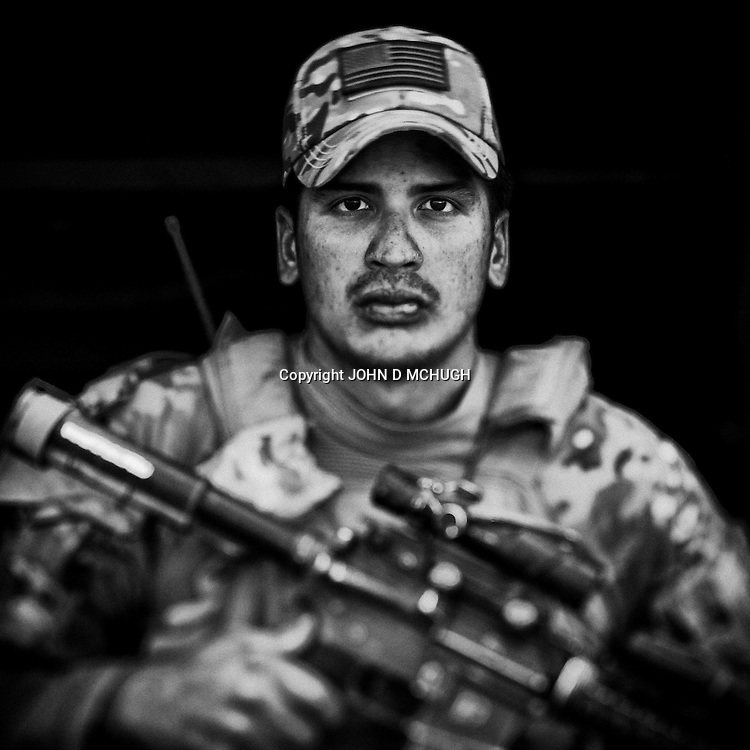 SGT Pineda of 1 Platoon, Delta Co, 1-66, 4th Infantry Division, is seen at Combat Outpost TJ in the Arghandab Valley, 04 May 2011. (John D McHugh)