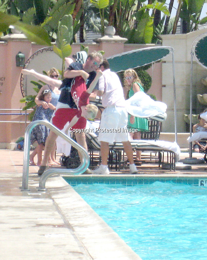 "8-2-08 Exclusive.Gordon Ramsey had lunch with his family then lounged by the pool at the Beverly hills hotel. Gordon was tossing his little kids in the pool with there cloths on left and right. Gordon was wearing a t-shirt that said ""I heart Locals."" He's a funny man..www.AbilityFilms.com.805-427-3519.AbilityFilms@yahoo.com"