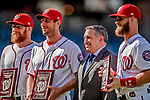 26 September 2018: Washington Nationals players (left to right) Sean Doolittle, Max Scherzer, and Bryce Harper receive Awards presented by MASN Reporter prior to a game against the Miami Marlins at Nationals Park in Washington, DC. The Nationals defeated the visiting Marlins 9-3, closing out Washington's 2018 home season. Mandatory Credit: Ed Wolfstein Photo *** RAW (NEF) Image File Available ***