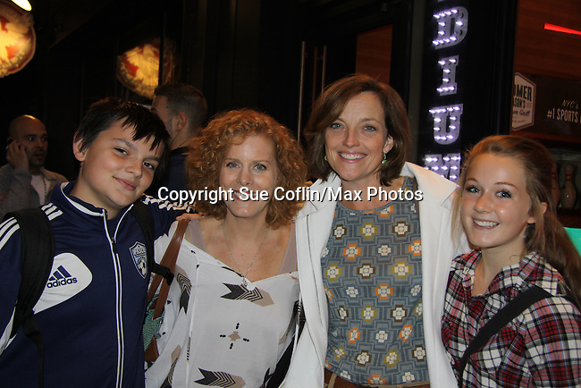 Guiding Light Orlagh Cassidy with her son Declan and Liz Keifer with daughter Bella at the 10th Annual Daytime Stars and Strikes Charity Event to benefit the American Cancer Society on October 13, 2013 at Bowlmor Lanes, New York City, New York.  (Photo by Sue Coflin/Max Photos)