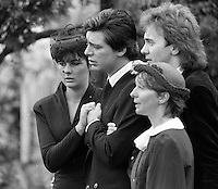 Pix: Copyright Anglia Press Agency/Archived via SWpix.com. The Bamber Killings. August 1985. Murders of Neville and June Bamber, daughter Sheila Caffell and her twin boys. Jeremy Bamber convicted of killings serving life...copyright photograph>>Anglia Press Agency>>07811 267 706>>..Jeremy Bamber is comforted by his girlfriend Julie Mugford at the funeral of his family, alongside Colin Caffell, father and husband of victims. no date..ref 0006 neg 25..