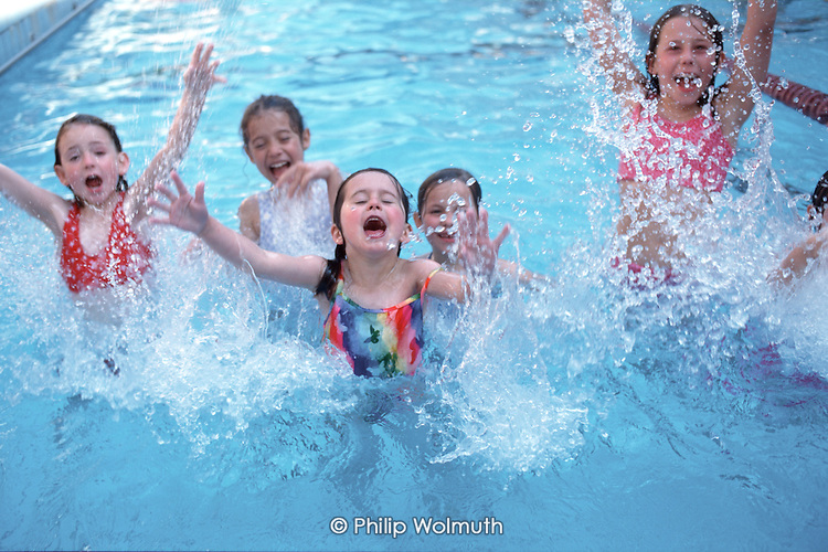 Children splash in the swimming pool at Camden Council's Oasis Sports Centre, Holborn, London.
