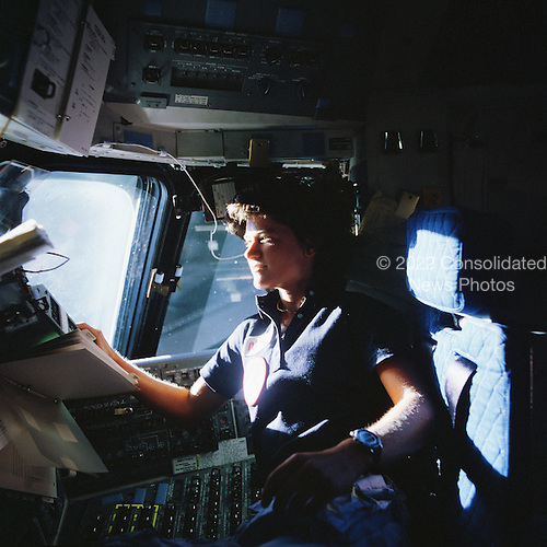 Astronaut Sally K. Ride, STS-7 mission specialist, communicates with ground controllers from the flight deck of the Earth-orbiting Space Shuttle Challenger on June 21, 1983.  Dr. Ride passed away due to Pancreatic Cancer on Monday, July 23, 2012..Credit: NASA via CNP