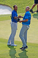 Tiger Woods (USA) shakes hands with Stewart Cink after finishing on the 18th hole during the third round of the 100th PGA Championship at Bellerive Country Club, St. Louis, Missouri, USA. 8/11/2018.<br /> Picture: Golffile.ie | Brian Spurlock<br /> <br /> All photo usage must carry mandatory copyright credit (&copy; Golffile | Brian Spurlock)