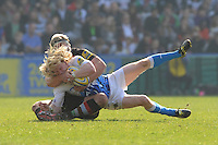 Tom Biggs of Bath Rugby is brought down by Joe Marler of Harlequins, who is awarded a yellow card, during the Aviva Premiership match between Harlequins and Bath Rugby at The Twickenham Stoop on Saturday 24th March 2012 (Photo by Rob Munro)